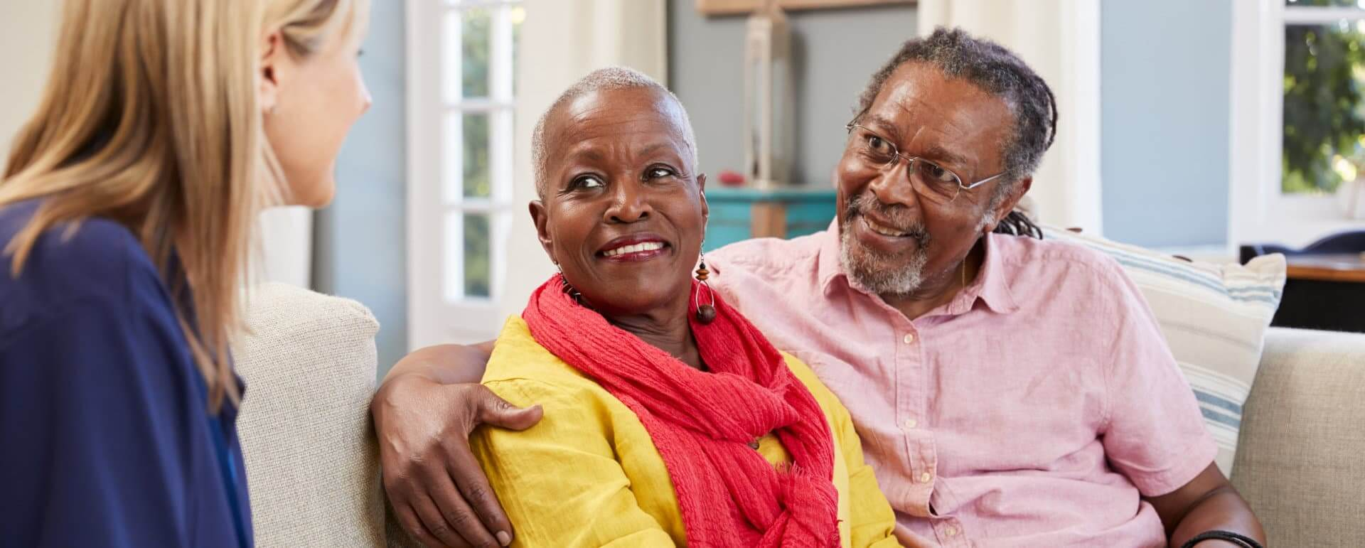 happy senior couple talking to their therapist