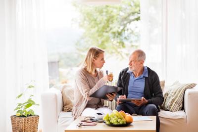 woman reminding senior man about his medication