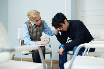teen age boy consulting to a psychiatrist
